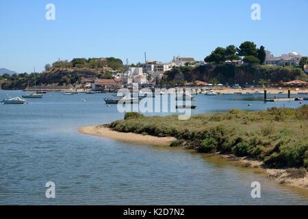 Saltmarsh and estuarine harbour at high tide with moored sailing yachts, Alvor, near Portimao, Algarve, Portugal, - Stock Photo