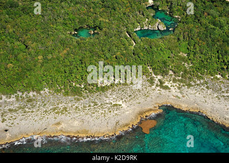 Aerial view of the cenotes, freshwater holes located all over the Yucatan peninsula, Mexico - Stock Photo