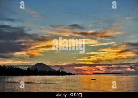Sunset on the volcano island of Manado Tua, Manado, Indonesia, Sulawesi Sea - Stock Photo