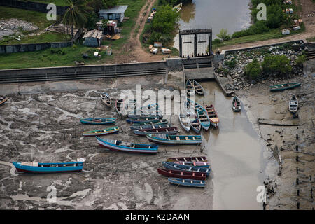 Fishing boats in the Hope canal, an irrigation canal in East Demerara Water Conservancy, coastal Guyana, South America - Stock Photo