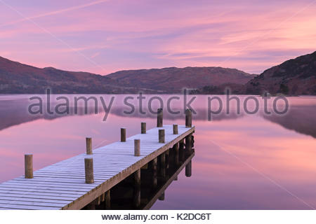 Frosty wooden jetty on Ullswater at dawn. Lake District, Cumbria, England, UK.November 2013. - Stock Photo