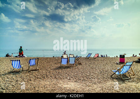 People relaxing on Brighton Beach, Brighton, Sussex, UK, Summer 2017 - Stock Photo