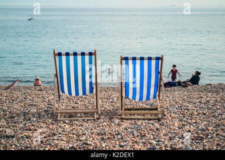 People relaxing on Brighton Beach, Brighton, Sussex, UK, Summer 2017 - Stock Photo