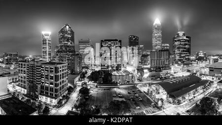 Black and white, aerial view of Charlotte, NC skyline on a foggy night. Charlotte is the largest city in the state - Stock Photo