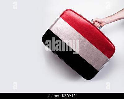 Yemen flag on a vintage leather suitcase. - Stock Photo