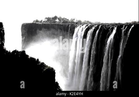 Black and white high contrast image of Victoria Falls in Zambia - Stock Photo