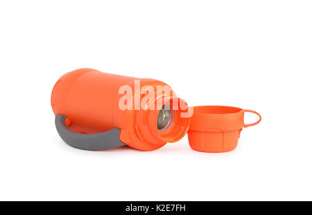 Empty modern orange thermos lying near mug on white background. Isolated with clipping path - Stock Photo