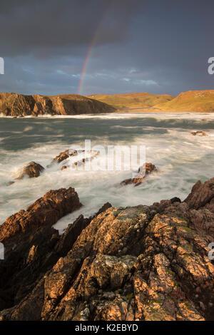 Stormy evening light with rainbow over Mangurstadh / Mangersta beach, Isle of Lewis, Outer Hebrides, Scotland, UK, - Stock Photo