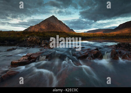 River Coupall flowing in front of Stob Dearg, Buachaille Etive Mor at sunrise, Glencoe, Lochaber, Scotland, UK, - Stock Photo
