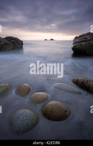 Porth Nanven beach in evening light, St Just, Cornwall, England, UK, June 2015. - Stock Photo
