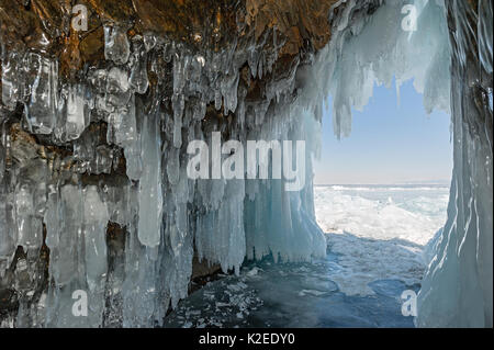 Cave filled with icicles / ice stalactites, Lake Baikal, Siberia, Russia, March 2015. - Stock Photo