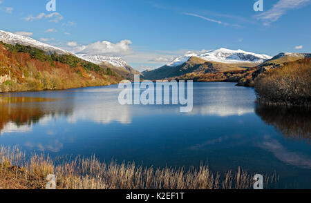 Llyn Padarn viewed from the northern end towards LLanberis with Mount Snowdon to the right in the background in - Stock Photo