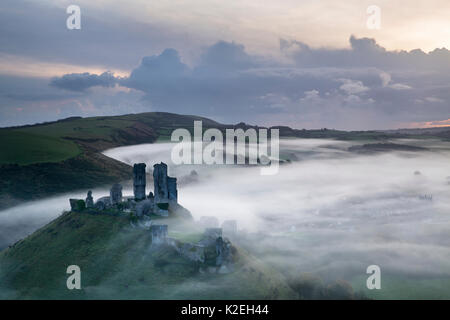 Corfe Castle in the mist at dawn, Dorset, England, UK, November 2014, - Stock Photo