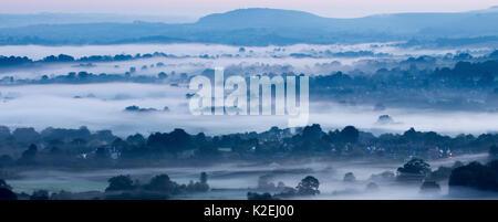 Panoramic of misty morning in the Blackmore Vale, Dorset, England, UK, September 2015. - Stock Photo