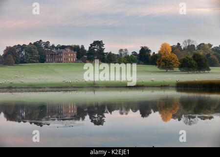 Berrington Hall reflected in lake at dawn, Herefordshire, England, UK, October 2015. - Stock Photo