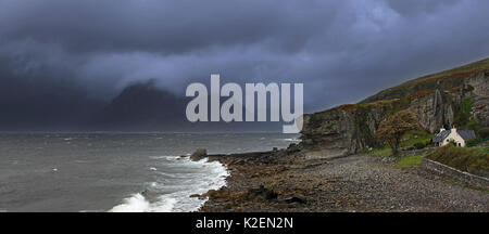 Rain clouds at sunset over the Cuillin Hills, viewed from Elgol on the Island Skye, Inner Hebrides, Scotland, UK, - Stock Photo