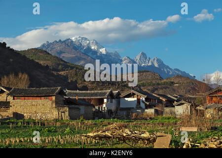 Landscape of village and mountains from near Lashihai lake, Lijiang City, Yunnan Province, China. January 2012 - Stock Photo