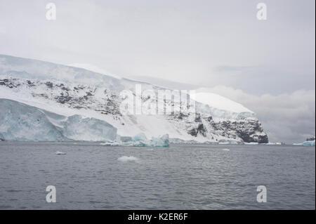 Coastline of Buckle Island.  Balleny Islands, Antarctica, February. - Stock Photo