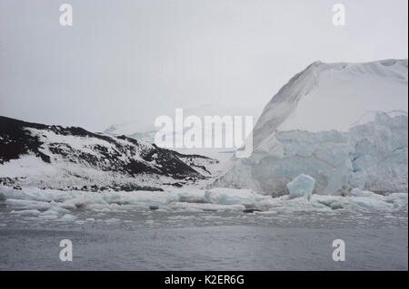 Coastline of Buckle Island, Balleny Islands, Antarctica, February. - Stock Photo