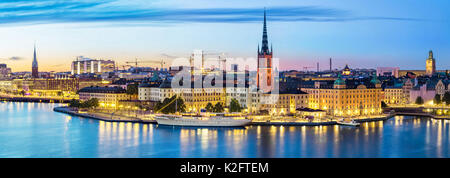 Panoramic view on Stockholm skyline in Old Town (Gamla Stan) in the evening, Sweden - Stock Photo