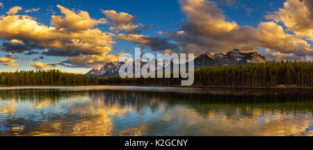 Sunset panorama of Herbert Lake along the roadside of the Icefields Parkway in Banff National Park, Alberta, Canada. - Stock Photo