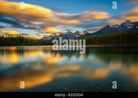 Scenic sunset over Herbert Lake along the roadside of the Icefields Parkway in Banff National Park, Alberta, Canada. - Stock Photo