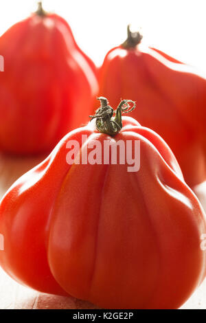 Coeur de Boeuf tomatoes close up - Stock Photo