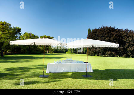 Glasses in a summer garden for a party - Stock Photo