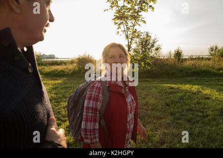 Happy caucasian elderly seniors couple in park - Stock Photo