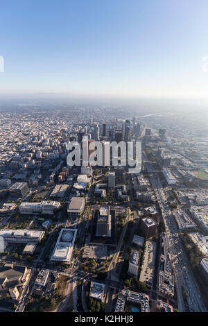 Los Angeles aerial view of urban downtown buildings, freeways and streets in Southern California.