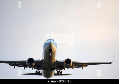 Commercial jet prepares for landing in an italian airport - Stock Photo