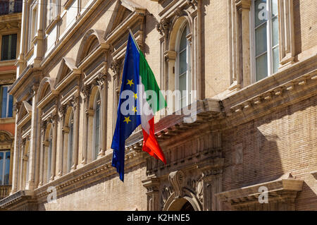 Italian and European Union flags on facade of the building in Rome, Italy - Stock Photo