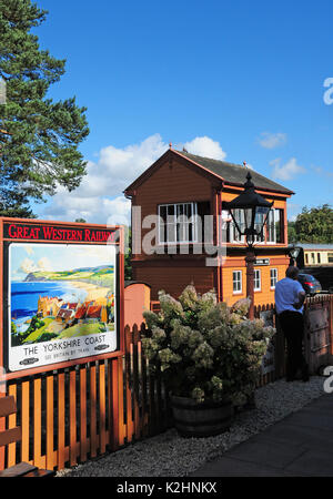 Signal box, preserved Great Western Railway poster and lamp at Arley on Severn Valley Railway, Shropshire. - Stock Photo