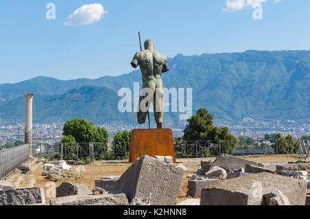Igor Mitoraj bronze sculpture at the Roman ruins of Pompeii, Italy - Stock Photo
