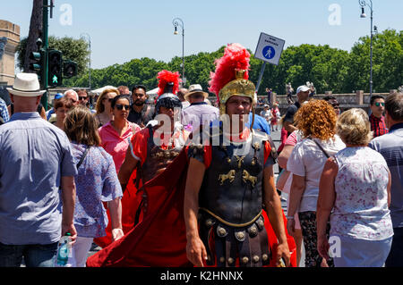 Men dressed as ancient Roman soldiers walking among tourists in Rome, Italy - Stock Photo