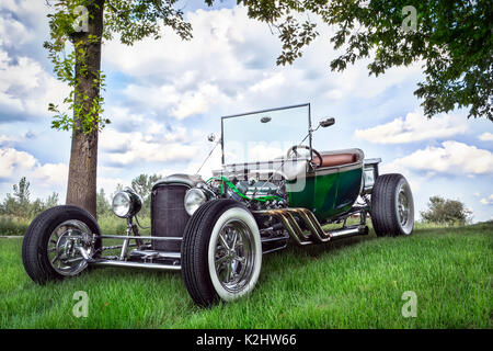 classic old vintage style luxory green car parked on grass background closeup summer a hot rod on the side of a wisconsin road stock photo