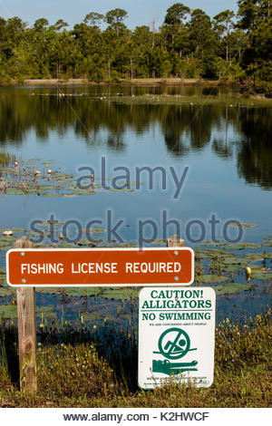 Beach park regulations sign stock photo royalty free for Florida freshwater fishing license