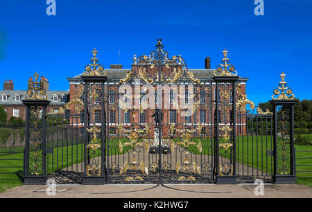 The gates of Kensington Palace in Hyde Park in London, England - Stock Photo