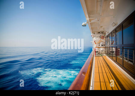 Cruise ship open deck in a sunny day - Stock Photo