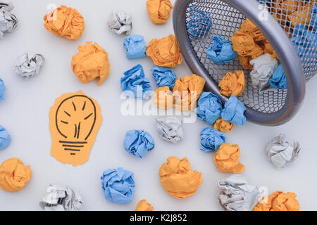 New Idea. Colorful crumpled paper balls rolling out of a trash can. Close up. Concept image. - Stock Photo