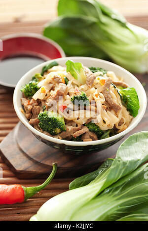 Rice noodles with beef and broccoli - Stock Photo