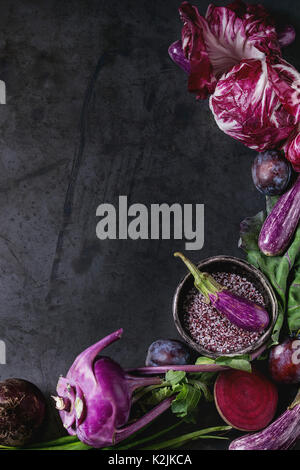 Assortment raw organic of purple vegetables mini eggplants, spring onion, beetroot, radicchio salad, plums, kohlrabi, - Stock Photo