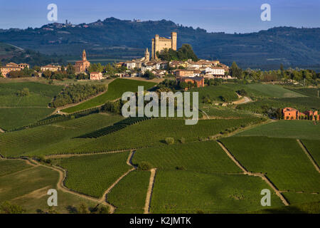 View over the village of Serralunga d'Alba and the wonderful hills with green vineyards of Langa, Piedmont - Stock Photo