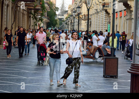 People walking on Nizami street in Baku. - Stock Photo