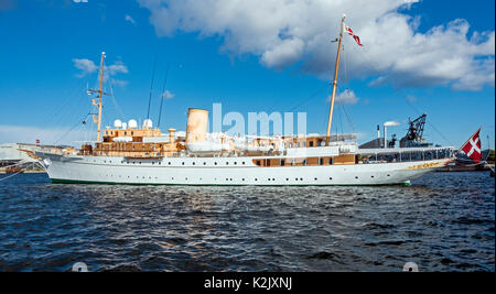 Royal Danish Yacht (Kongeskibet) Dannebrog moored between Nordre Toldbod and the navvy, station in the harbour of - Stock Photo