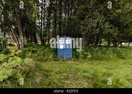 A London Police Public Call Box known by the fictional name of TARDIS from television's Dr Who along the side of - Stock Photo