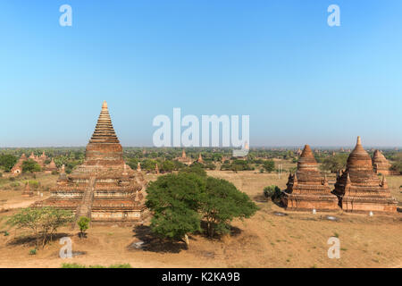 Many old pagodas and other buildings at the ancient plain of Bagan in Myanmar (Burma), viewed from the Bulethi (Buledi) - Stock Photo