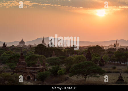 Silhouette of old many temples and pagodas at the plain of Bagan at sunset in Myanmar (Burma). Copy space. - Stock Photo
