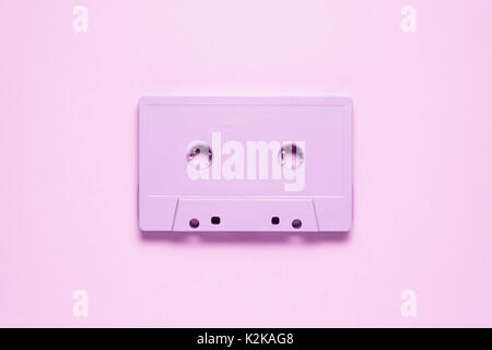 Creative photo of  painted cassette on pink  background. - Stock Photo