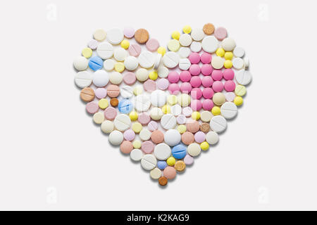 Creative healthcare and medicine concept photo of heart made of drugs and pills on white background. - Stock Photo